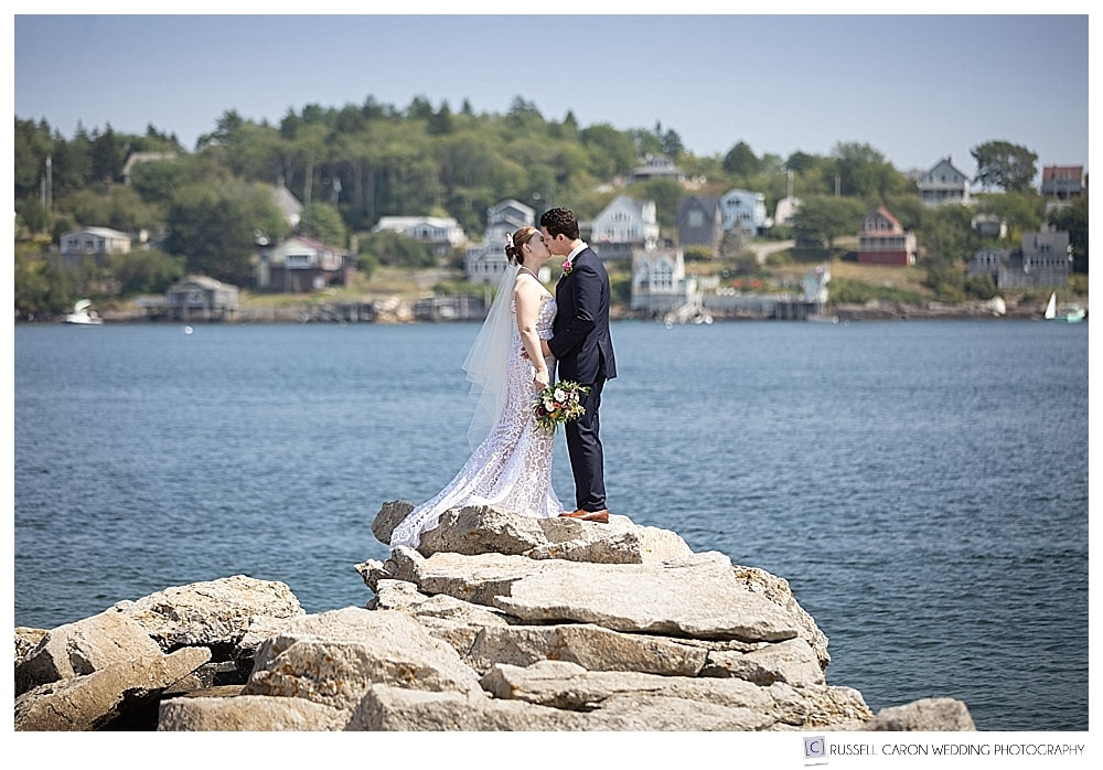 bride and groom kissing at the end of a jetty in Phippsburg Maine