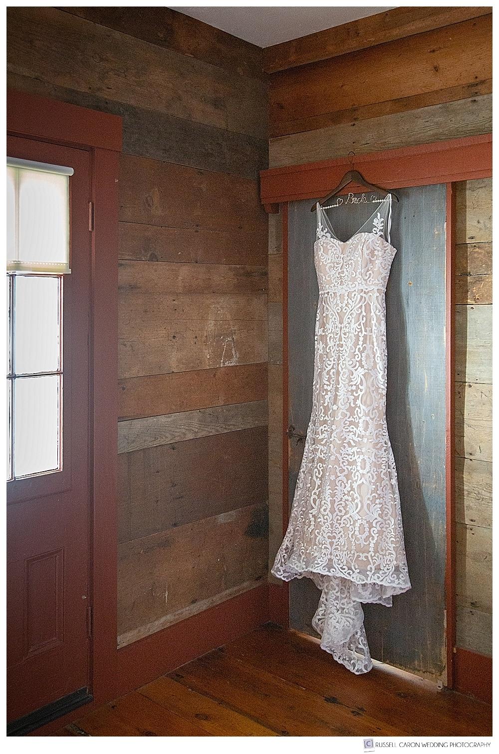 wedding dress hanging on a rustic door