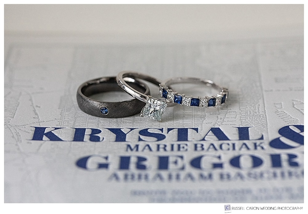 wedding rings atop an invitation from Bayview Printing Company