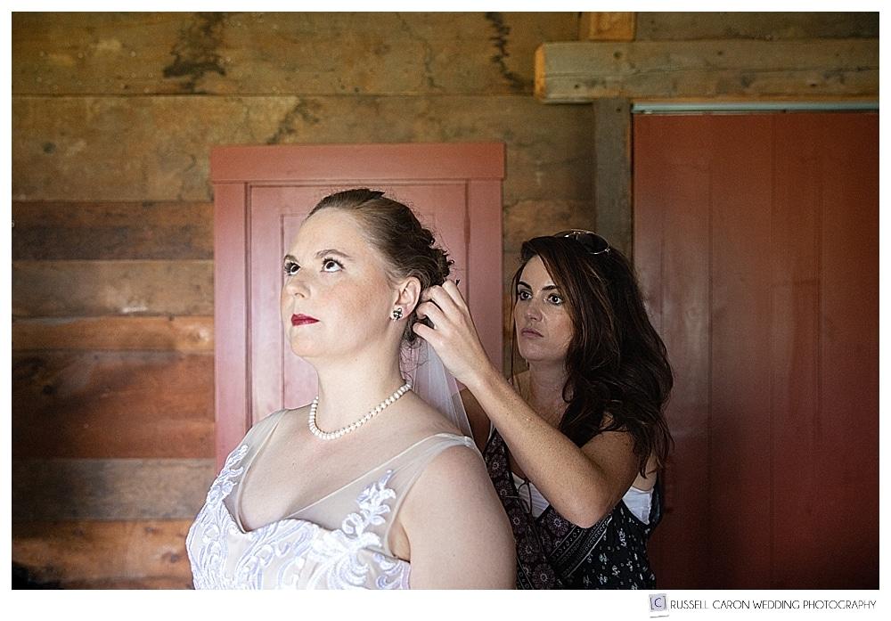 bride getting veil installed