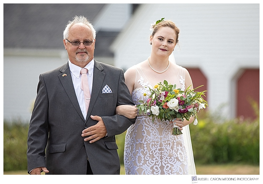 bride and her father walking down the aisle at a 1774 Inn outdoor wedding