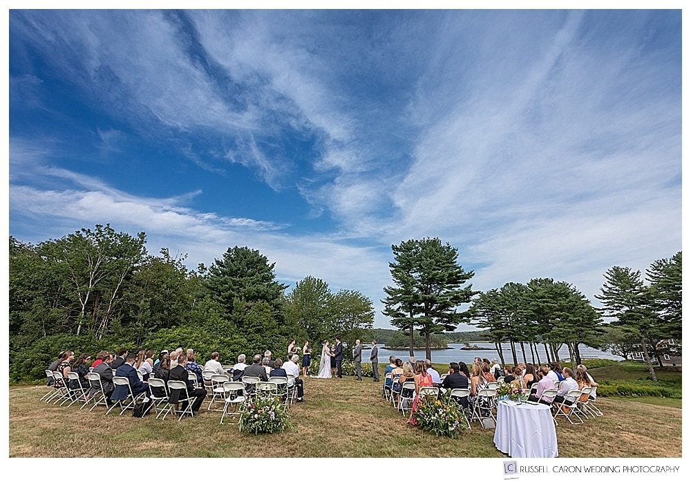 outdoor wedding ceremony on the knoll at the 1774 Inn in Phippsburg, Maine