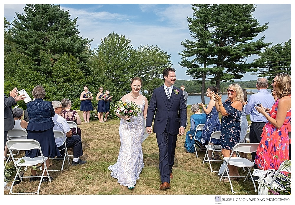 bride and groom during recessional after their 1774 Inn wedding ceremony