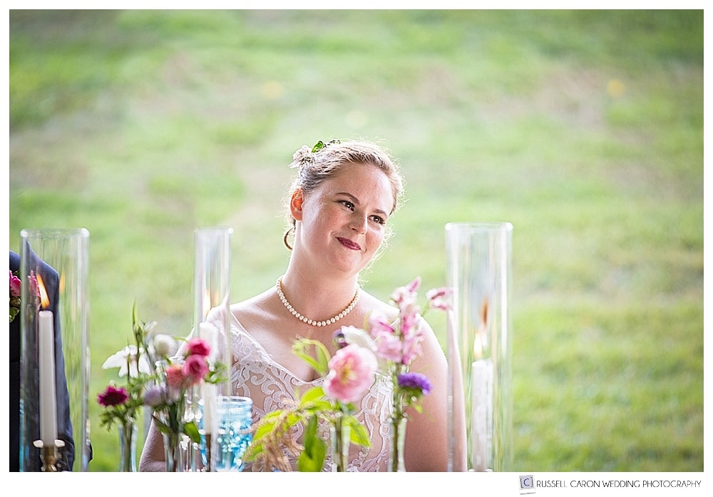bride sitting at table, smiling