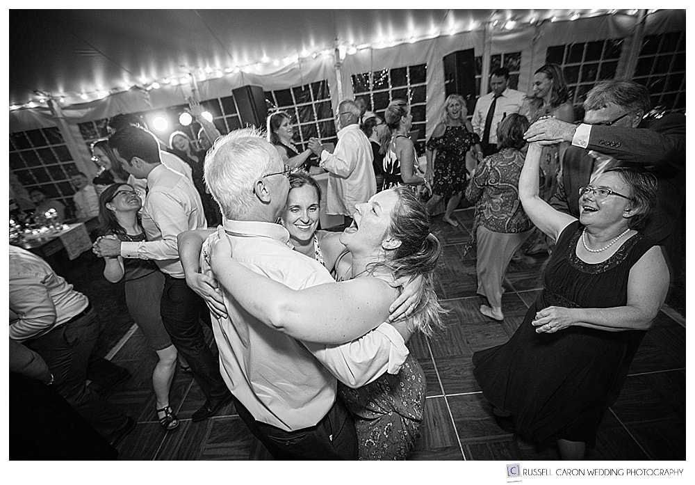 black and white photo of people having fun on the dance floor