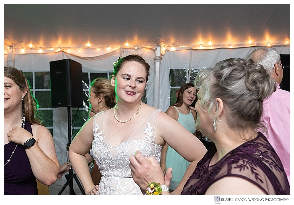 bride standing and talking with a woman