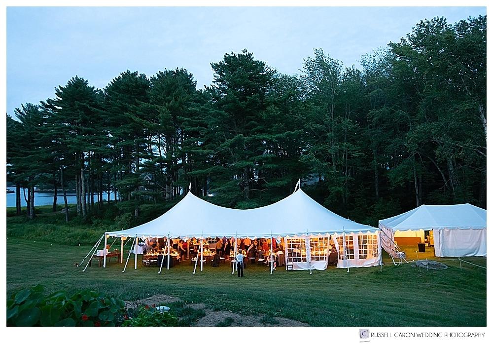 Marshall tent at wedding reception at dusk