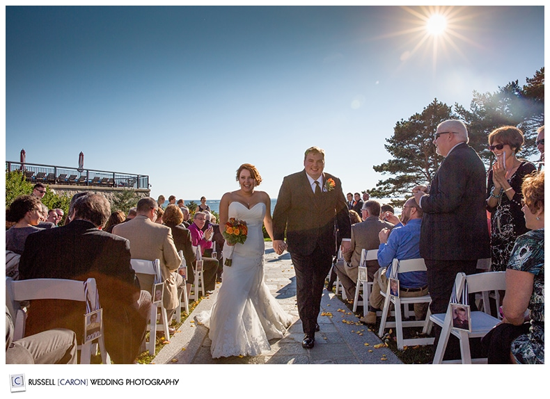 bride and groom during recessional at colony hotel wedding