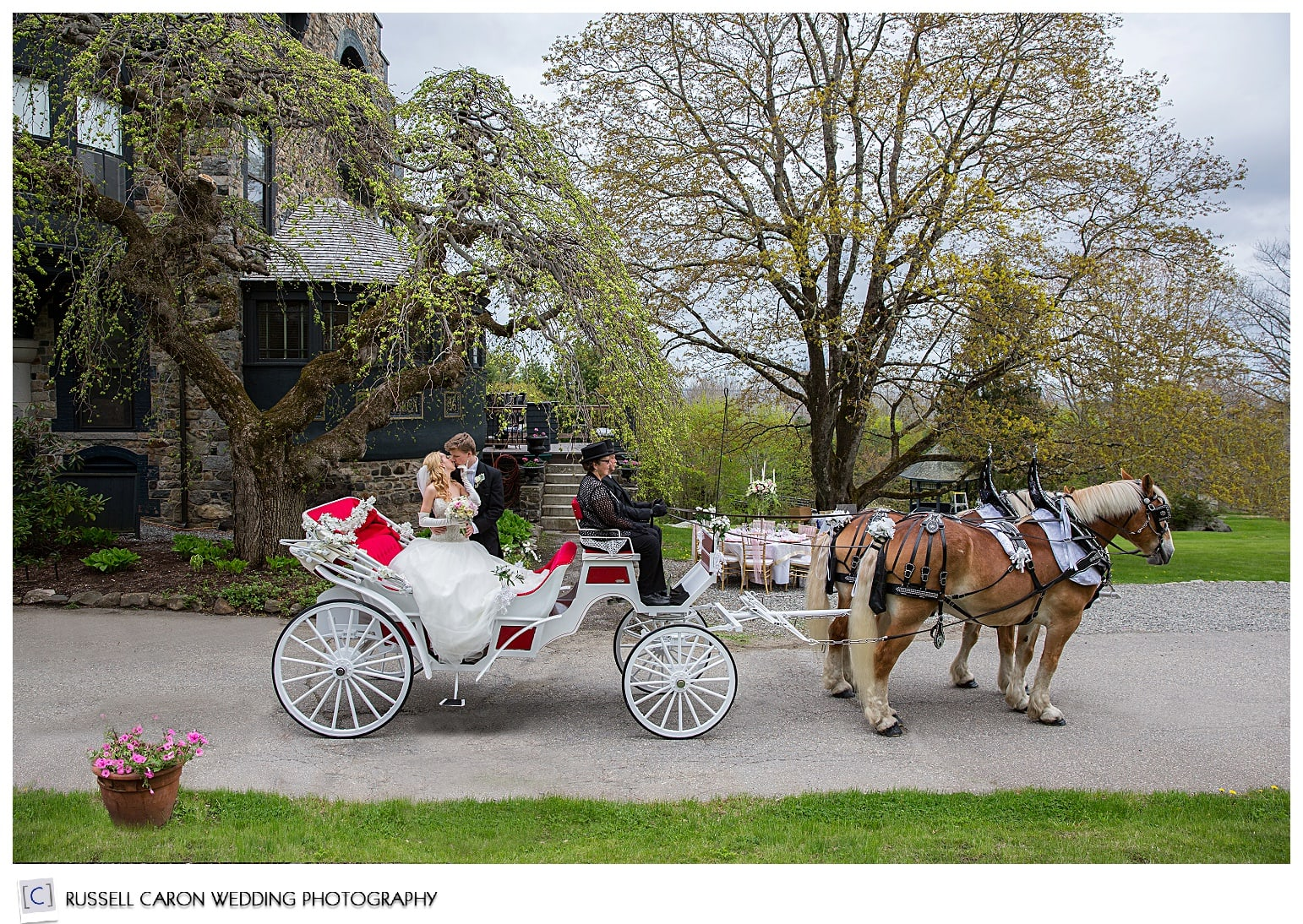 Couple in horse drawn carriage at the Norumbega Inn, Camden Maine wedding
