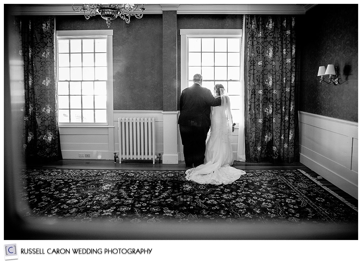 Bride and father looking out of the window