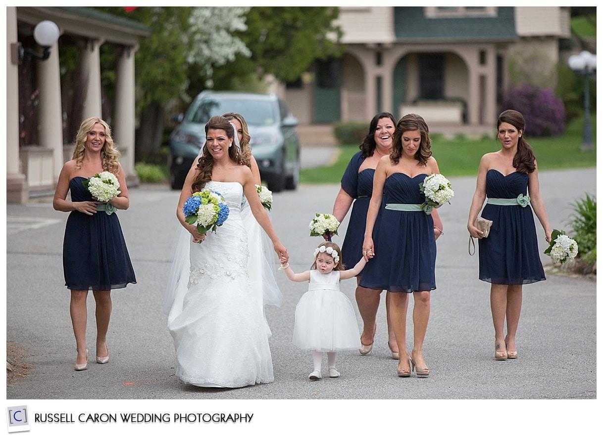 Bride and bridesmaids crossing street