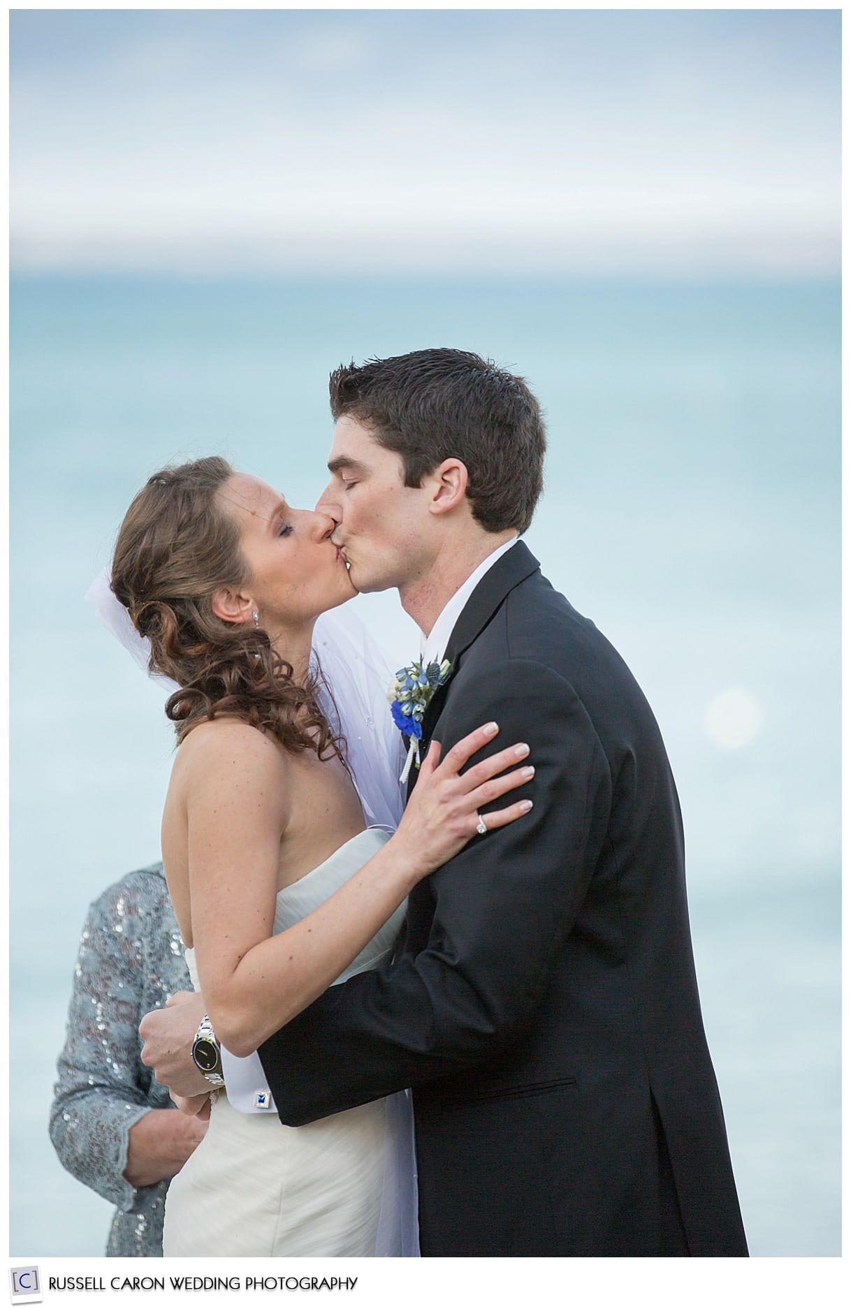 Bride and groom during the first kiss