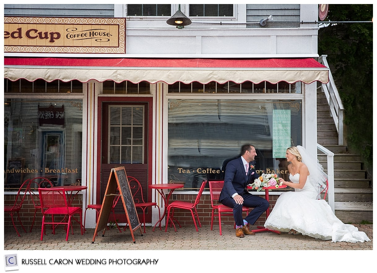 Bride and groom downtown Boothbay Harbor, by Boothbay Harbor Maine wedding photographers, Russell Caron Wedding Photography