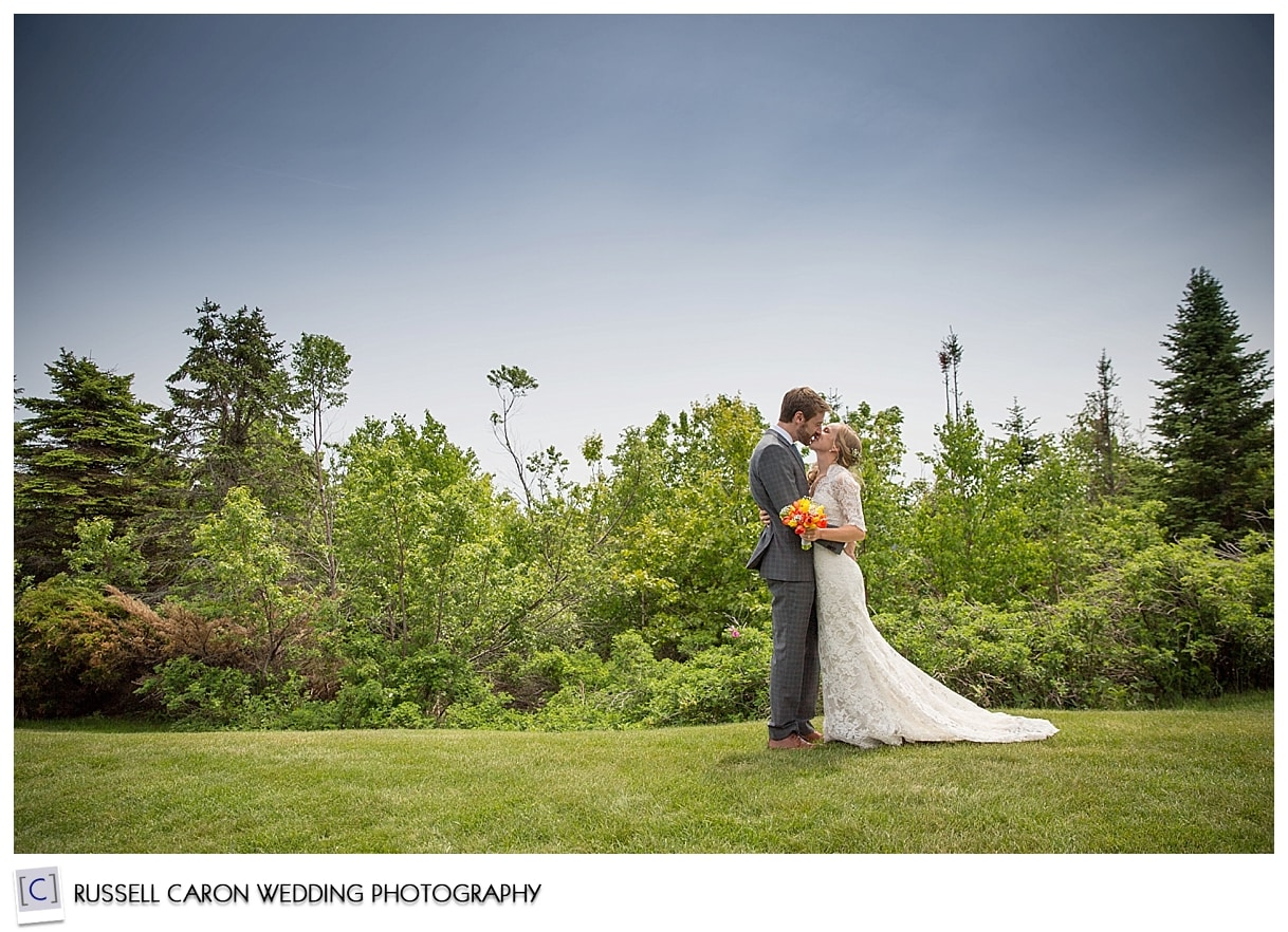 Bride and groom on the lawn