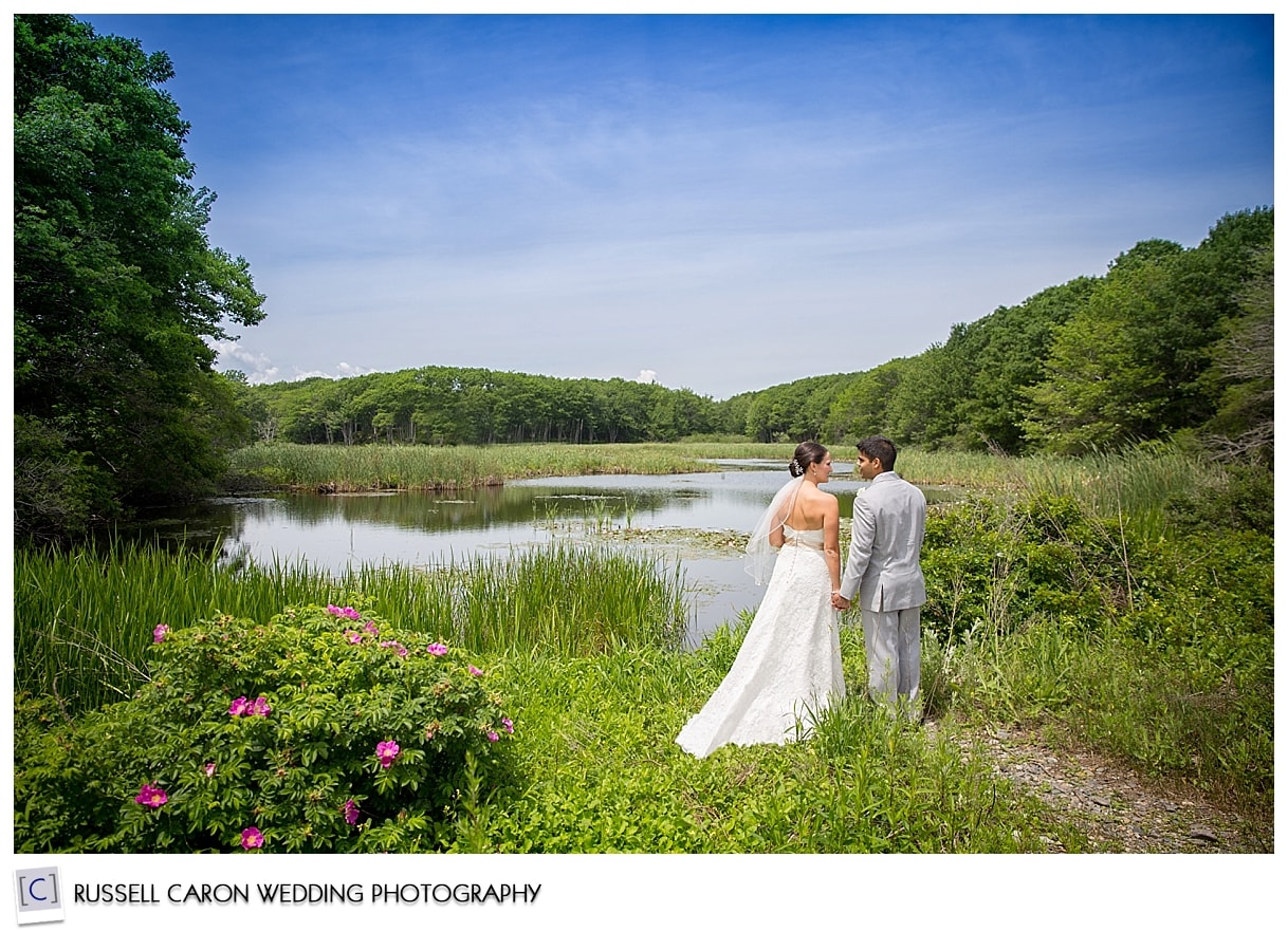 bride-and-groom-at-ponds-edge