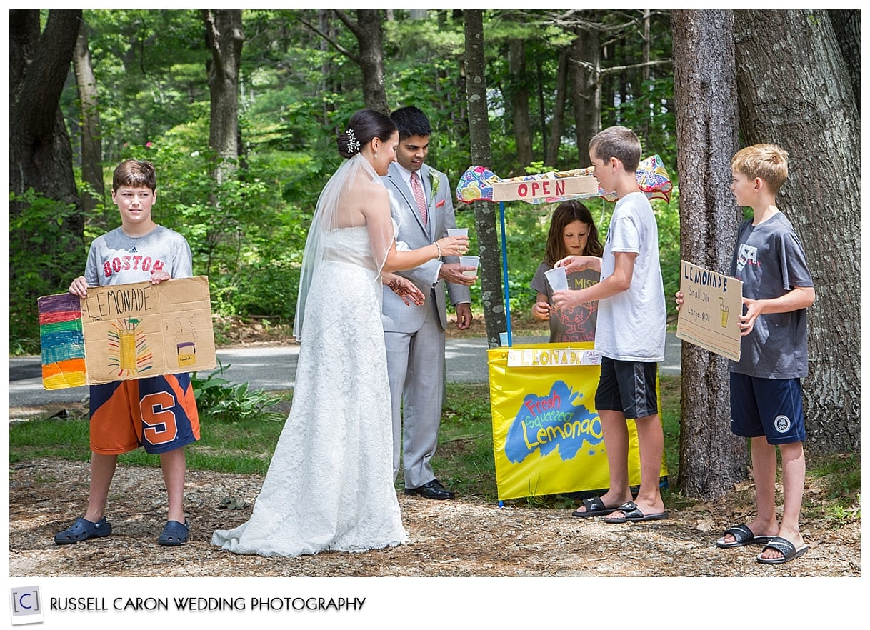 Bride and groom at lemonade stand in Kennebunkport, Maine
