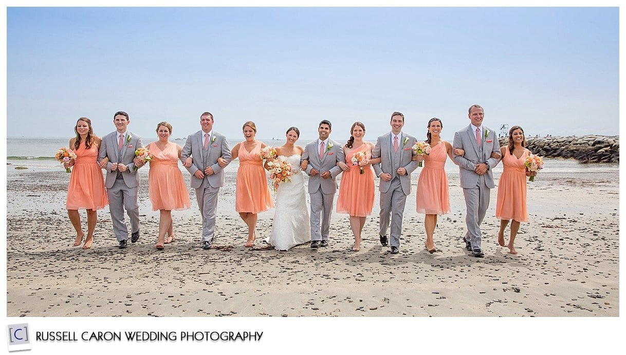 Bridal party arm in arm at Colony Beach