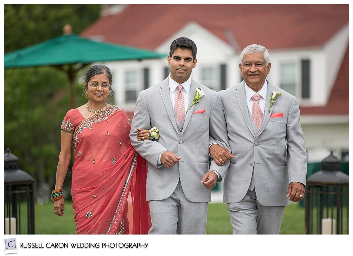 Groom and parents during wedding processional