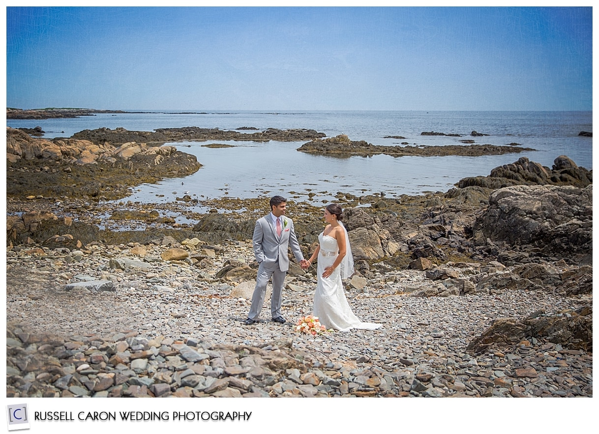 Bride and groom at the ocean