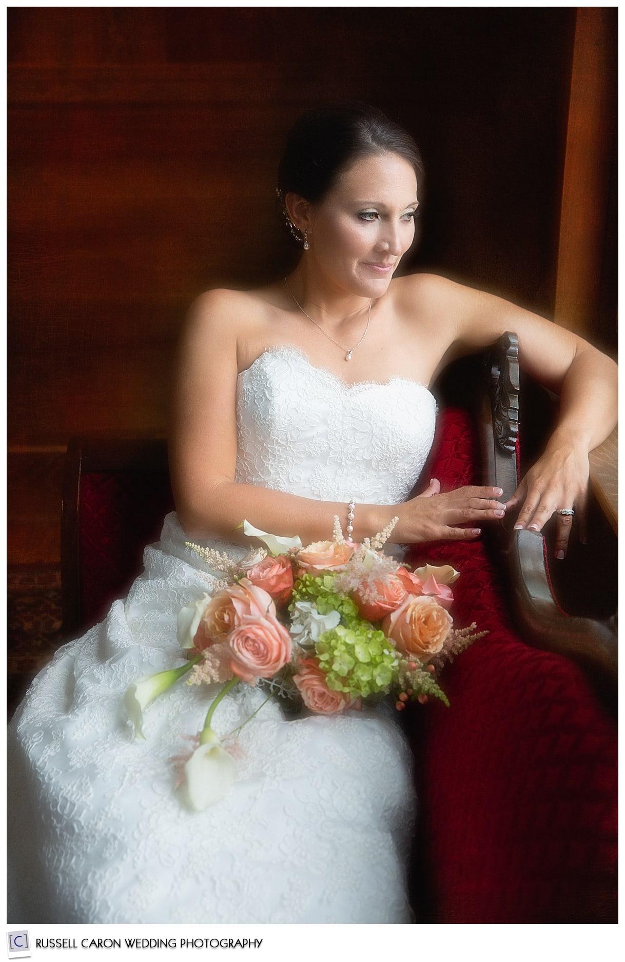Bride on settee, bridal portrait