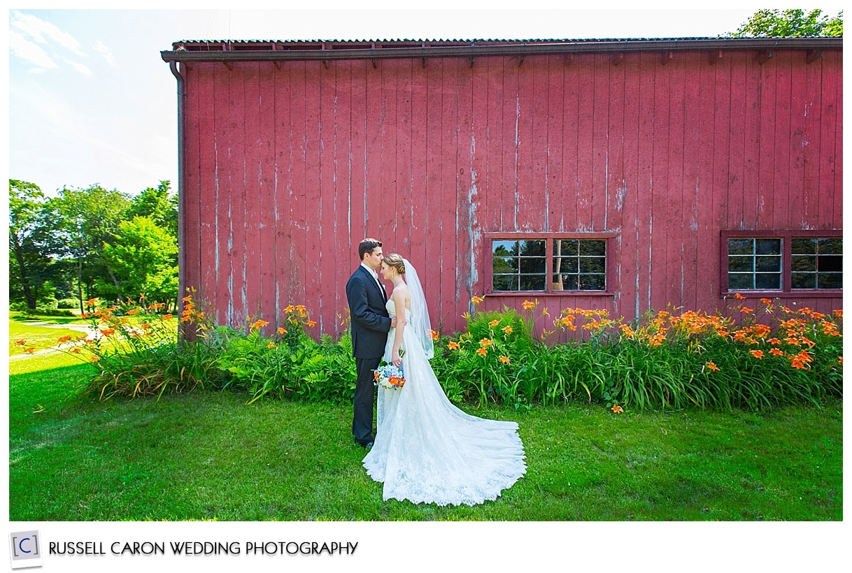 New England wedding photography with bride and groom in front of barn