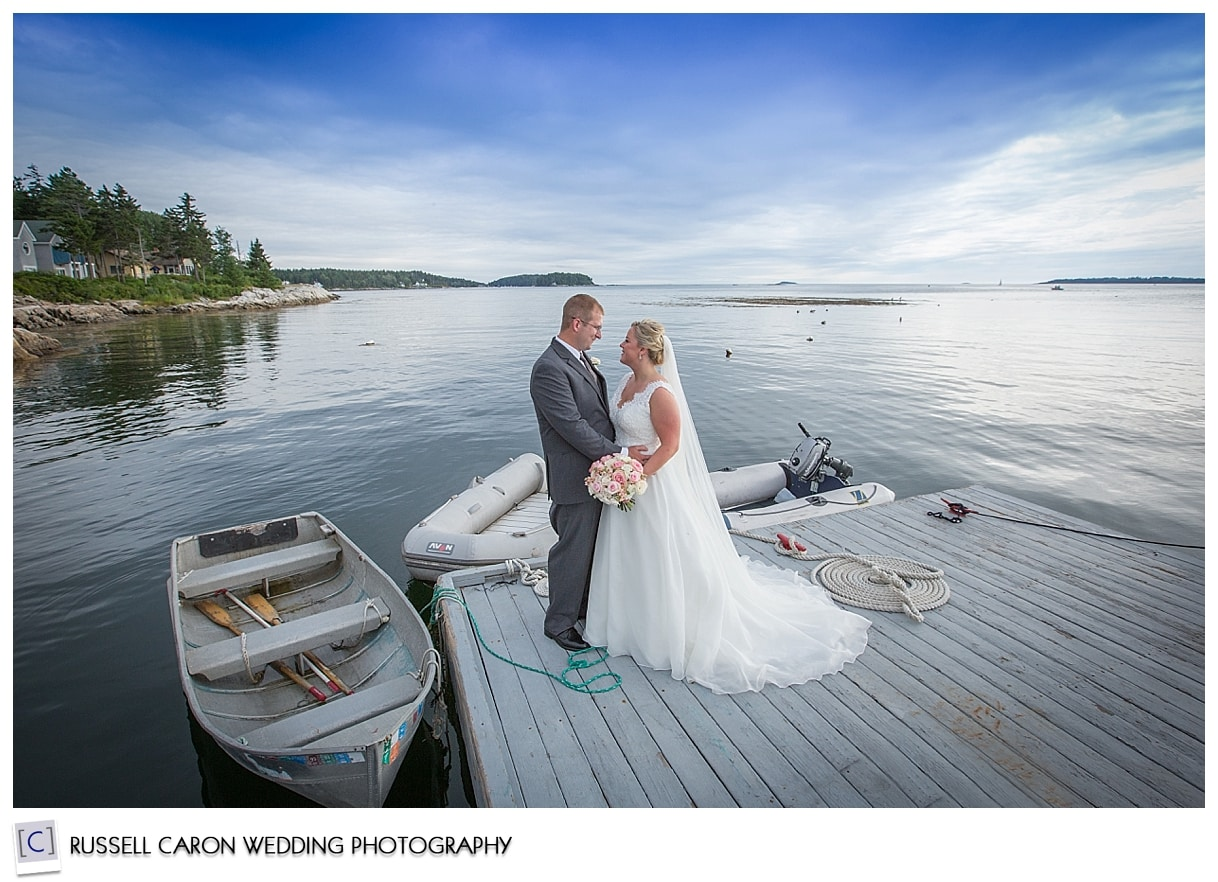 Bride and groom on the dock at Sebasco Harbor Resort, by Sebasco Harbor wedding photographers, Russell Caron Wedding Photography