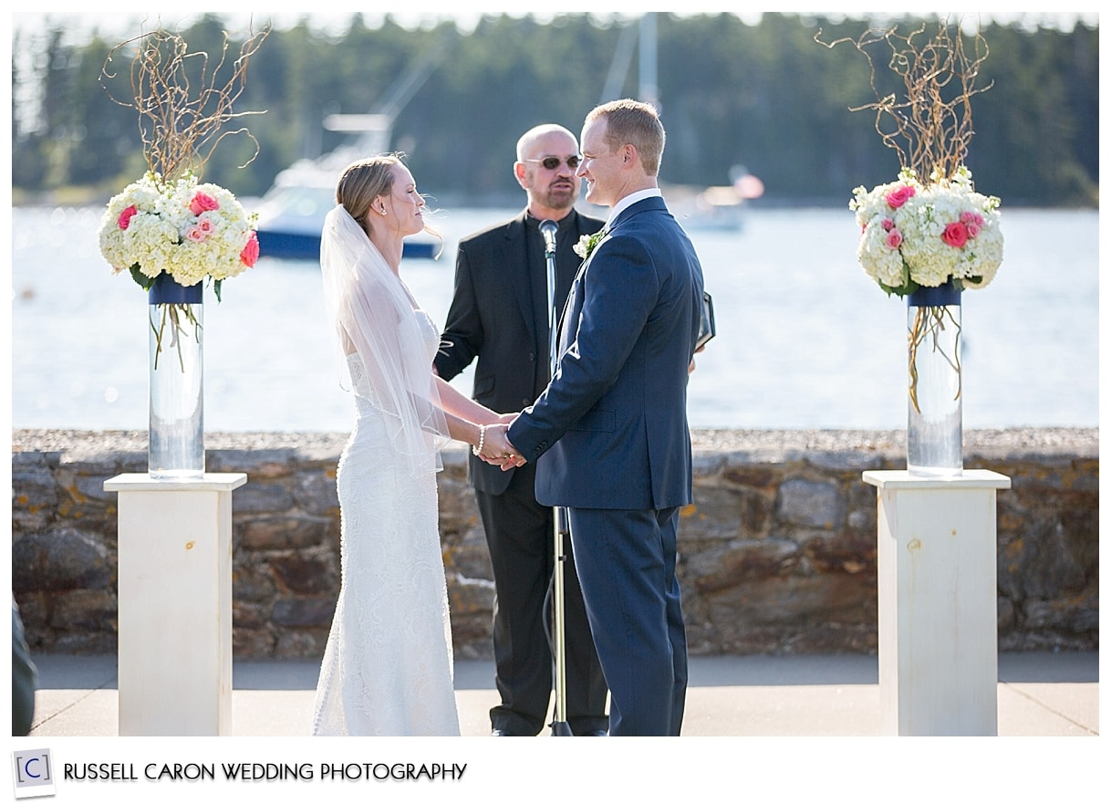 Bride and groom in front of officiant at wedding