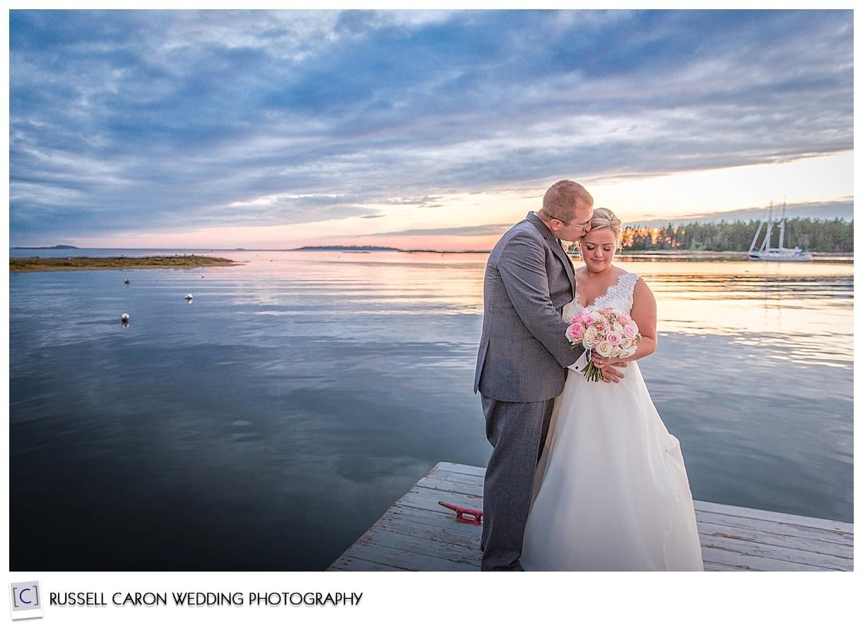 bride and groom at sunset on the dock at Sebasco Resort, Phippsburg, Maine