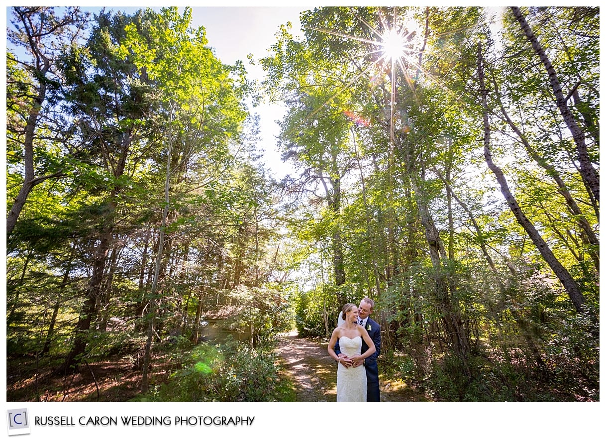 bride and groom in a wooded area at Sebasco Resort