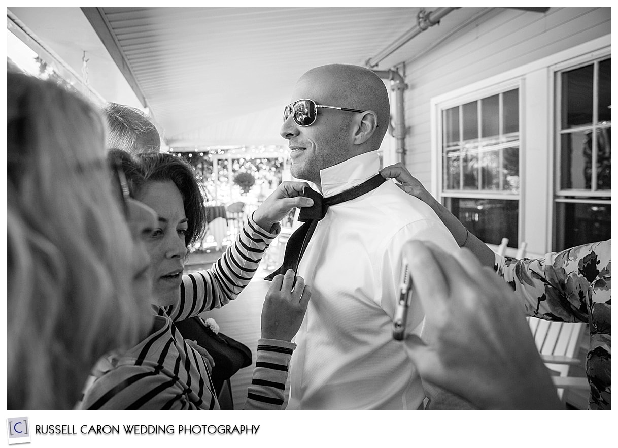 groom-getting-his-bow-tie-tied