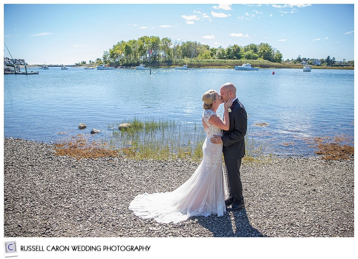 bride-and-groom-kissing-on-the-beach
