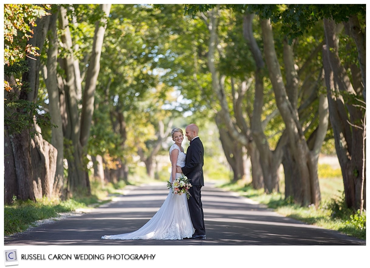 bride-and-groom-on-tree-lined-road