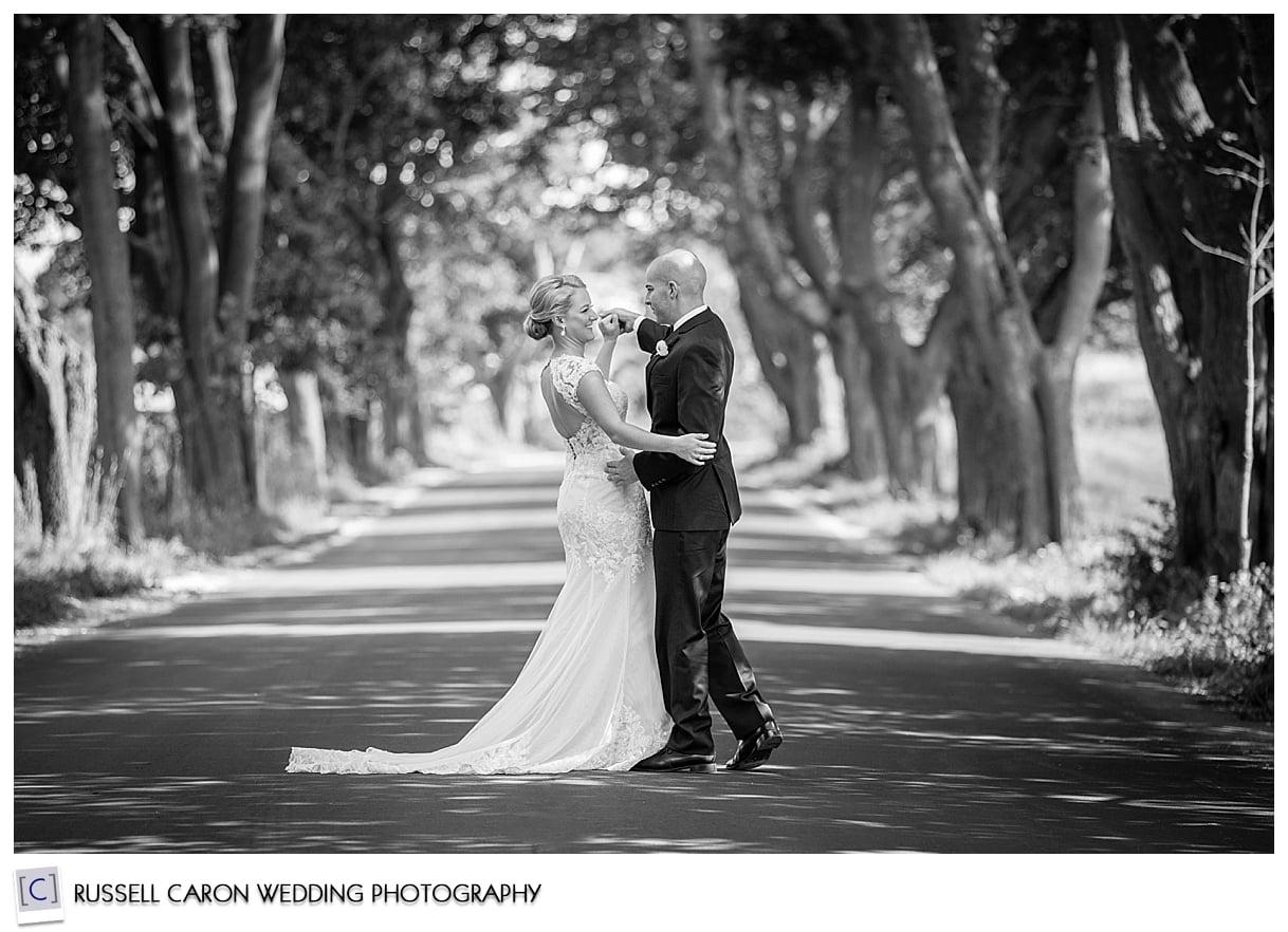 bride-and-groom-dancing-on-tree-lined-street