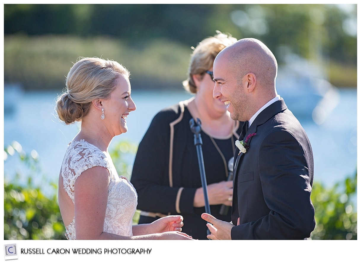 bride-and-groom-laughing-during-wedding-vows