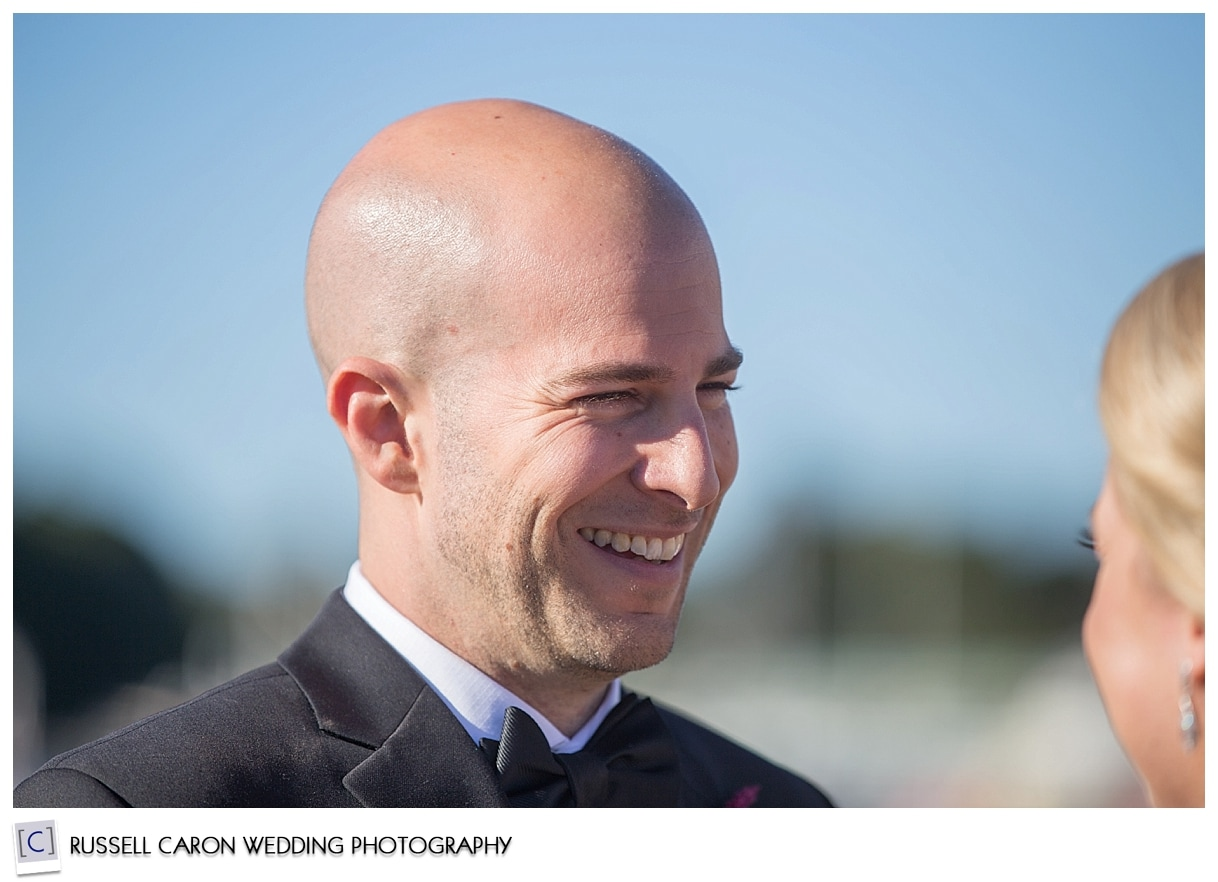 groom-during-outdoo-rwedding-ceremony-kennebunkport-maine