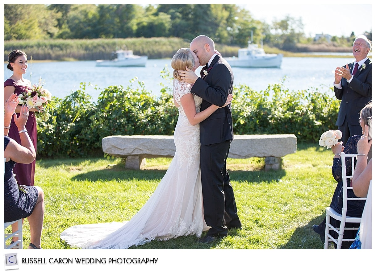 bride-and-groom-during-first-kiss-at-nonantum-resort-wedding-kennebunkport