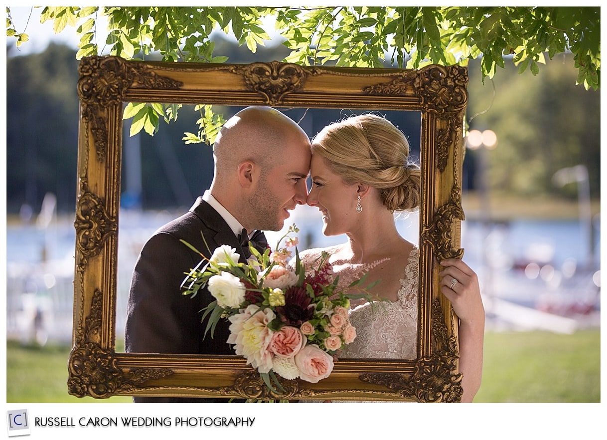 bride-and-groom-pose-in-picture-frame