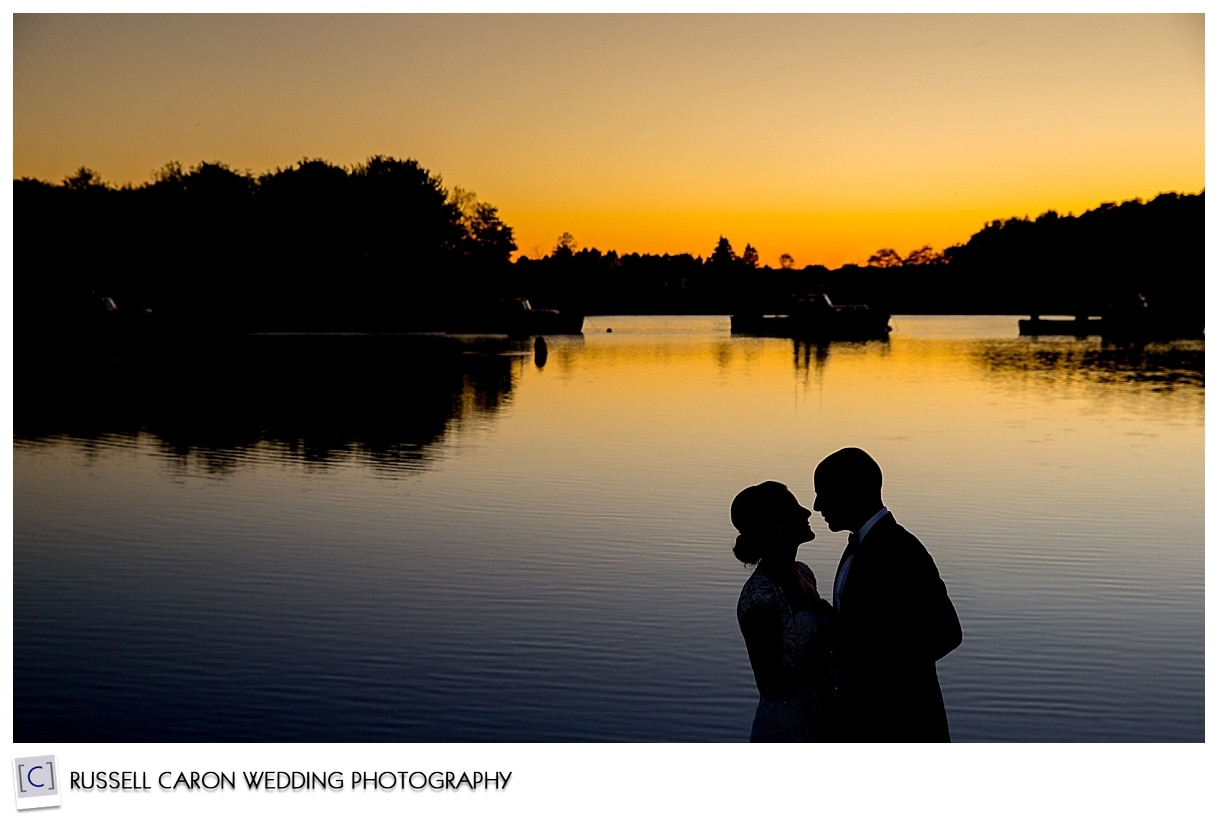silhouette-of-bride-and-groom-during-sunset
