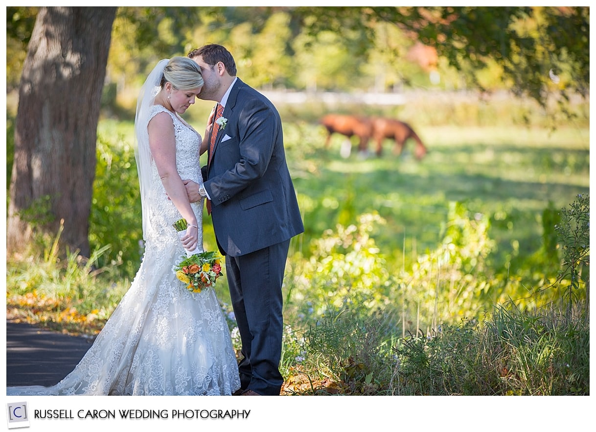 Bride and groom next to field, Suzi and Tyler, 2015 best wedding blog posts, by Kennebunkport Maine wedding photographers, Russell Caron Wedding Photography