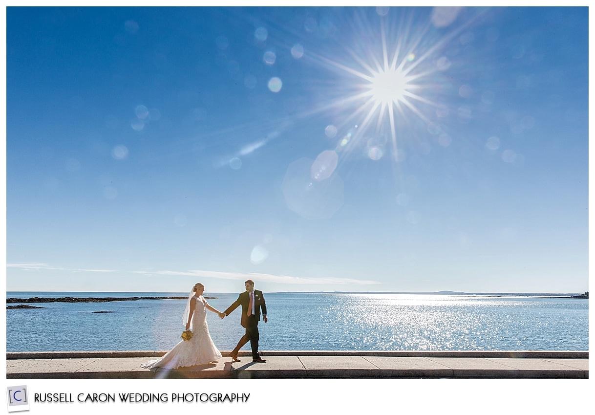 bride-and-groom-walking-along-beach
