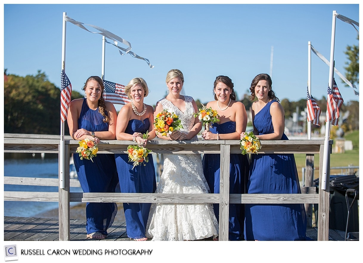 bride-and-bridesmaids-on-nonantum-resort-dock-kennebunkport-maine