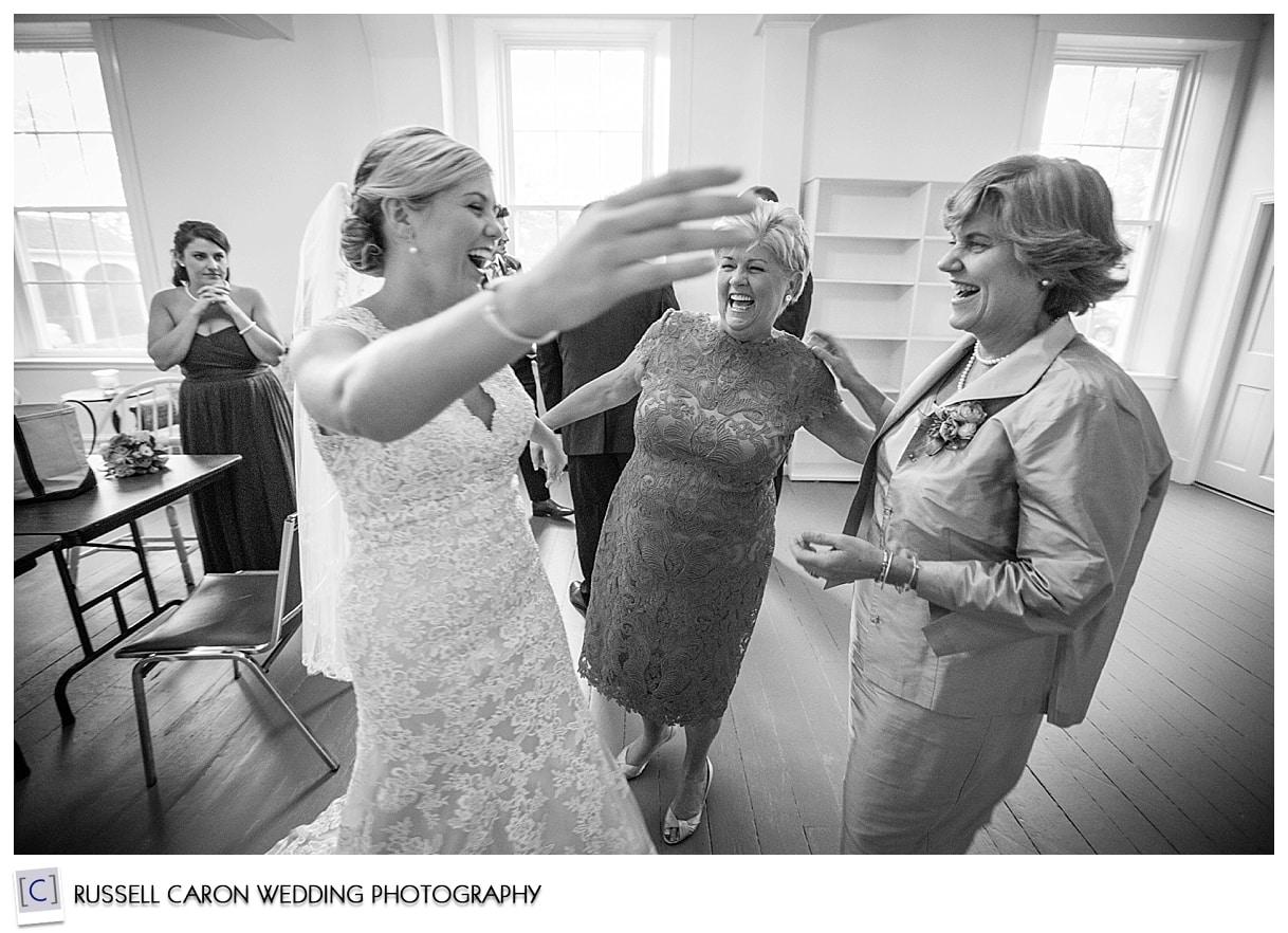 bride-hugging-family-after-wedding-ceremony