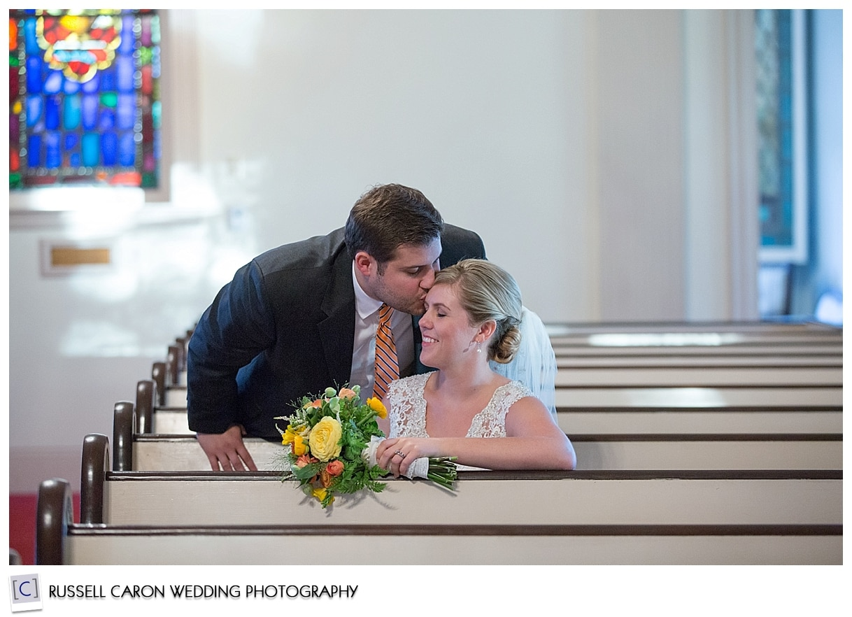 bride-and-groom-kissing-in-south-congregational-church
