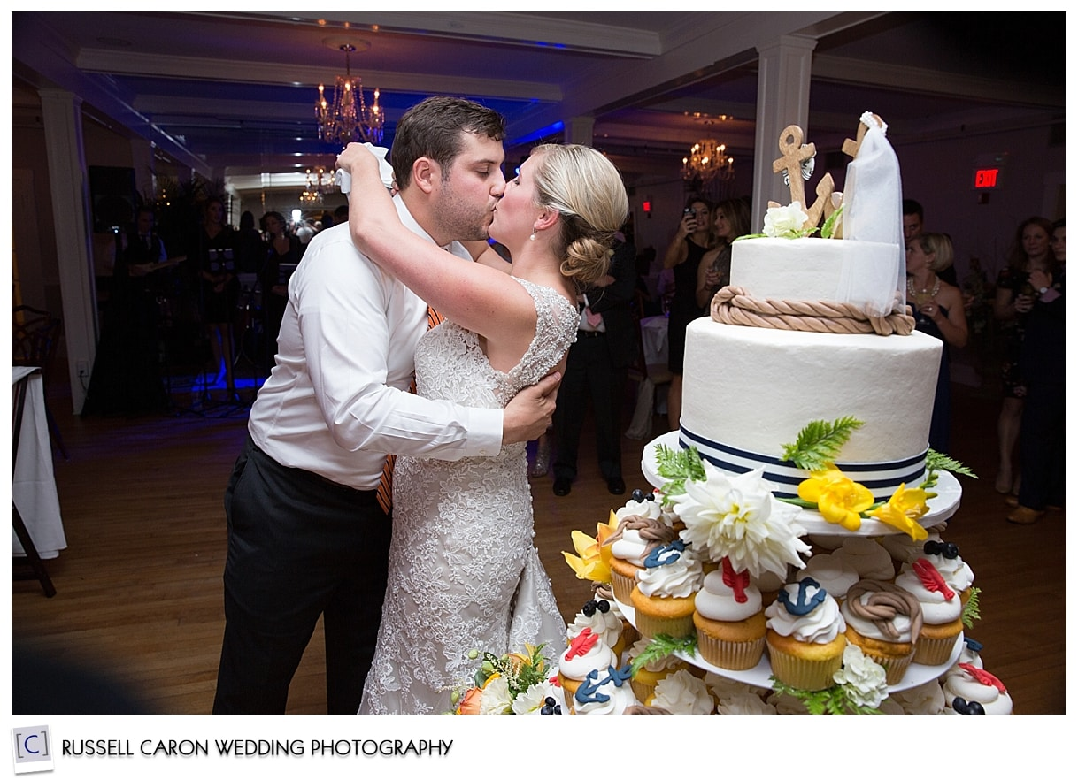 bride-and-groom-kissing-after-cake-cutting