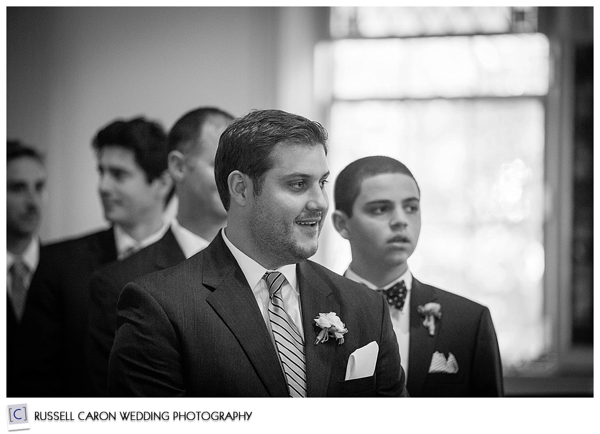 groom-watches-bride-during-processional-south-congregational-church-kennebunkport