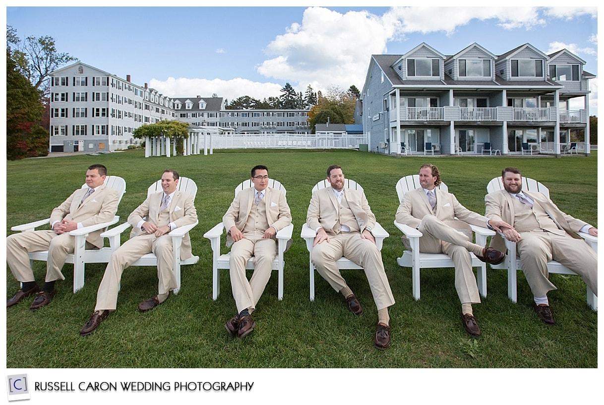 groom-and-groomsmen-sitting-in-adirondacks