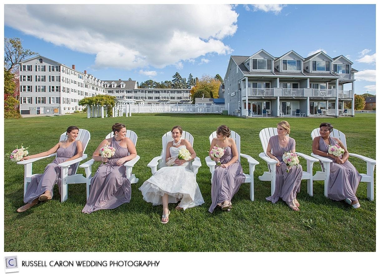 bride-and-bridesmaids-sitting-in-adirondacks