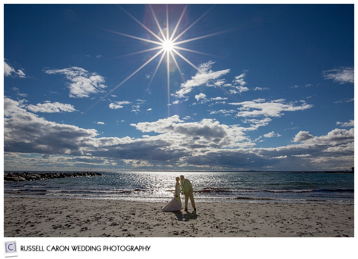 Bride and groom on the beach in Kennebunk Maine, by Kennebunkport Maine wedding photographers, Russell Caron Wedding Photography