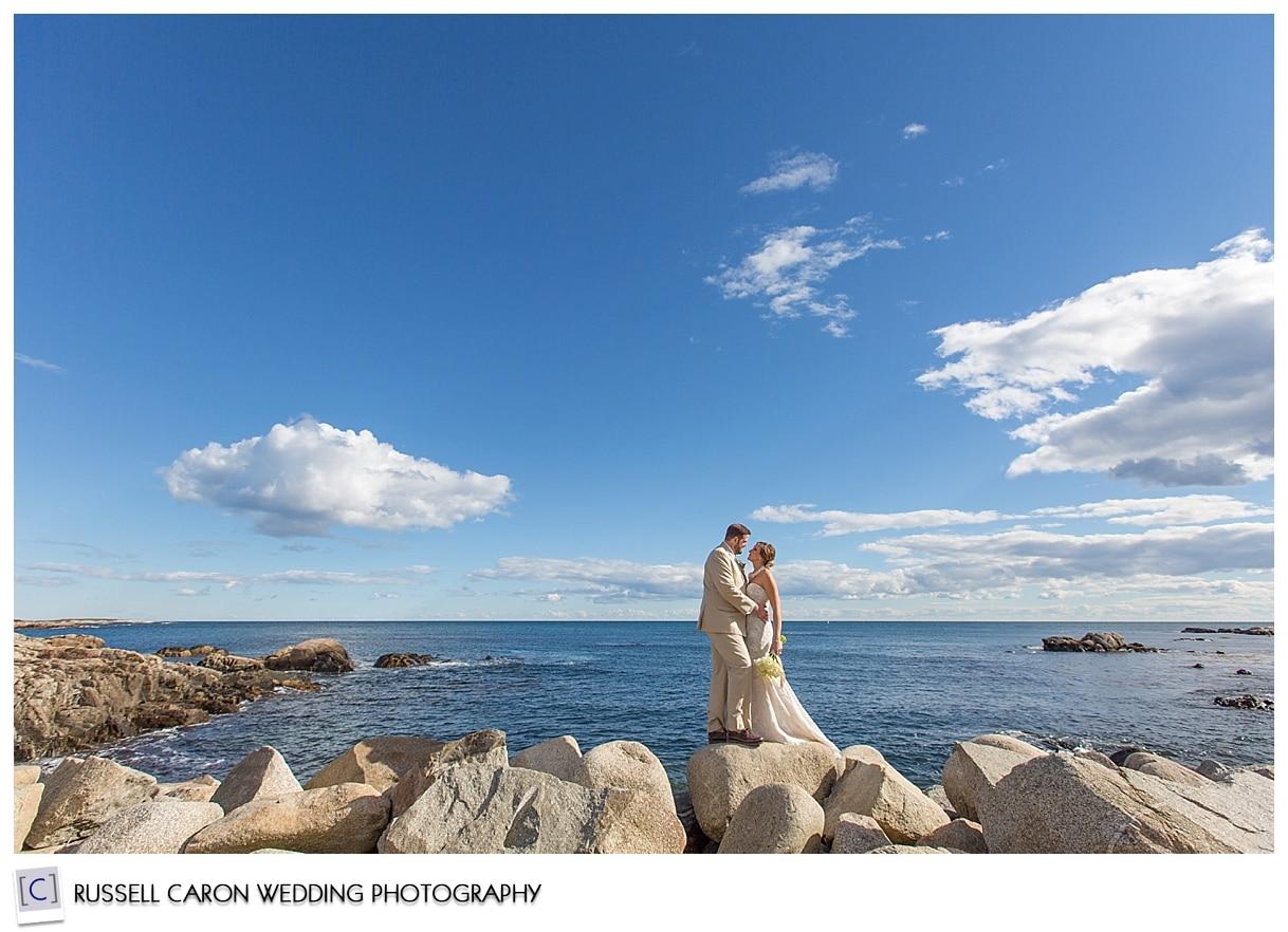 bride-and-groom-on-breakwater