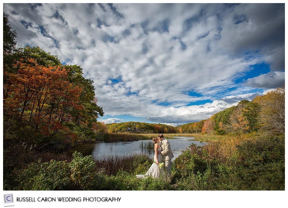 bride-and-groom-amid-fall-foliage